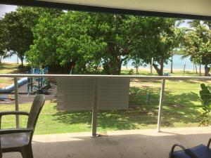 A balcony or terrace at Whitehaven Beachfront Holiday Units