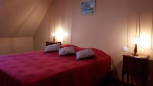Un ou plusieurs lits dans un hébergement de l'établissement Le Clos du Vieux Chêne
