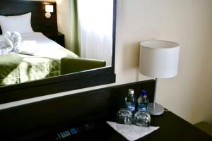 A bed or beds in a room at Aparthotel Travel