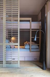 A bunk bed or bunk beds in a room at Clos du Savoy