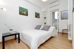 A bed or beds in a room at Cozy Domar - My Extra Home