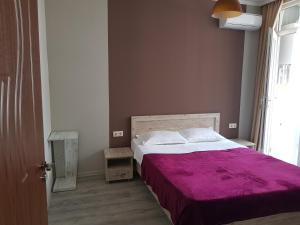 A bed or beds in a room at 1st Batumi