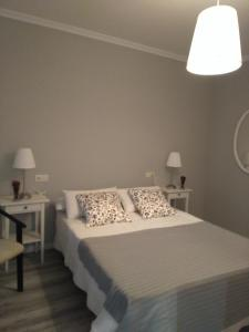 A bed or beds in a room at Torre Center