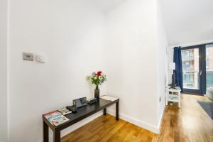 A television and/or entertainment center at Greenwich Two Bedroom Apartments