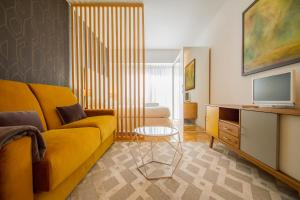 Zona de estar de UD Apartments - Atocha Stylish with pool