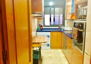 A kitchen or kitchenette at Nasta Vilanova Apartment HUTB-017614