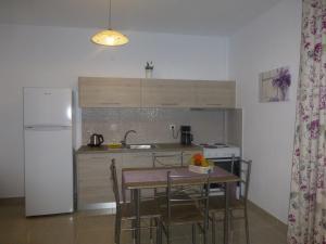 A kitchen or kitchenette at Pavloudis Apartments