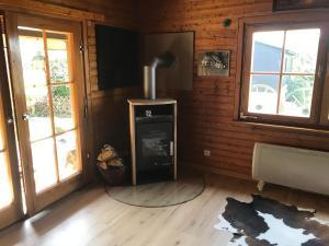 Televízia a/alebo spoločenská miestnosť v ubytovaní Ferienhaus Sauerland