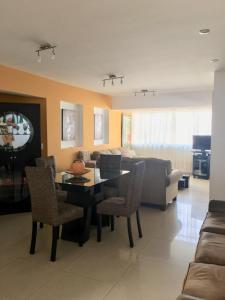 A restaurant or other place to eat at MIRAFLORES PENTHOUSE FOR 13, 5 Rooms/4 baths - Excelent Location