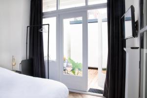 Letto o letti in una camera di Maison BON Apartment