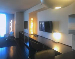 A television and/or entertainment center at Palms Place - 27th Floor Strip View Studio