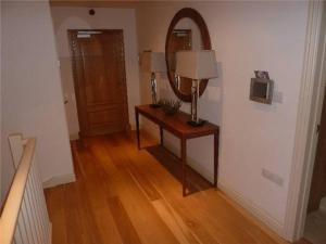 A television and/or entertainment center at Ground Floor 2 Bed Apartment, Murray Crescent House