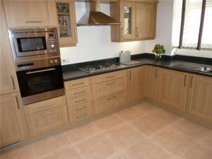 A kitchen or kitchenette at First Floor 3 Bed Apartment, Murray Crescent House