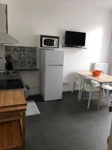 Cuisine ou kitchenette dans l'établissement Bilocale in Avenue du Progres