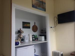 A television and/or entertainment center at Tui Apartment