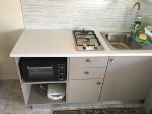 A kitchen or kitchenette at Kastraki Studios