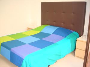 A bed or beds in a room at Costa Natura 602