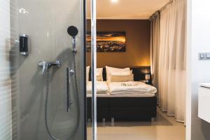 A bathroom at SILESIA Apartment