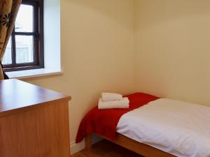 A bed or beds in a room at The Haybarn