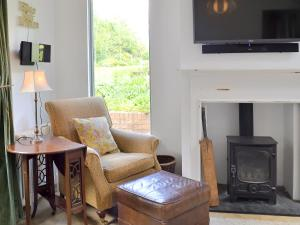 A television and/or entertainment center at Priory Cottage