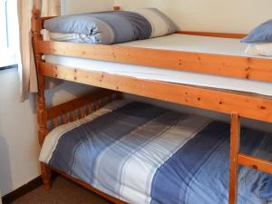 A bunk bed or bunk beds in a room at Stable Cottage