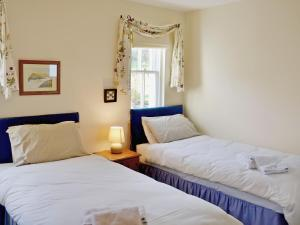A bed or beds in a room at Sanctuary Cottage