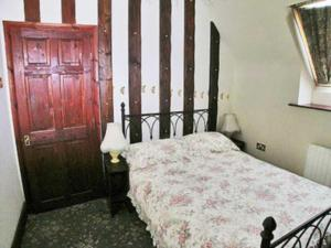 A bed or beds in a room at Chapel House