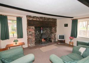 A seating area at Maxmills Cottage