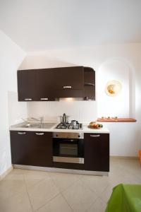 Kuchyň nebo kuchyňský kout v ubytování A Borgo Frigole