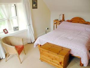 Ein Bett oder Betten in einem Zimmer der Unterkunft Old Stable Cottage