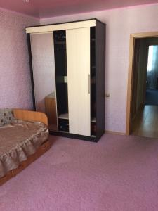 Кровать или кровати в номере Звездная 22