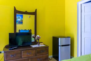 A television and/or entertainment center at Dreams Negril Rooms