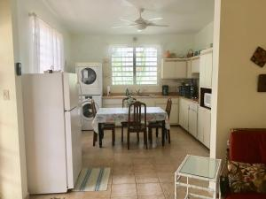 A kitchen or kitchenette at Tranquility by the Sea