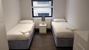 A bed or beds in a room at Access Tower Hill