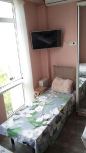 A bed or beds in a room at Apartment Nagorny