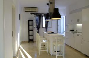 A kitchen or kitchenette at Helios Studios & Apartments