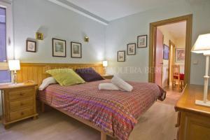Llit o llits en una habitació de Apartarent 1500