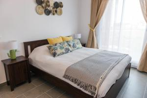 A bed or beds in a room at Unik San Juan