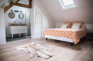 Un ou plusieurs lits dans un hébergement de l'établissement Les maisons de Charlotte