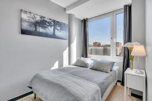 A bed or beds in a room at Forenom Serviced Apartments Oslo Carl Berners Plass