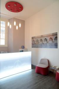 The lobby or reception area at Le Stanze del Lago Apartments