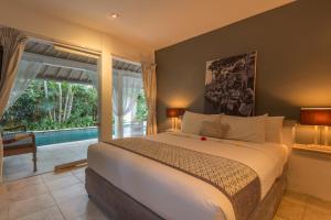 A bed or beds in a room at Esha Villa Drupadi I