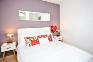 A bed or beds in a room at Sea View Apartment at urbanisation Las Farolas