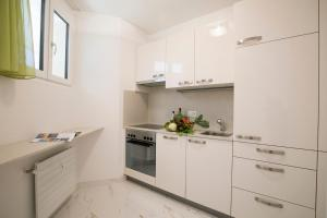 A kitchen or kitchenette at Monte Bre' Apartment