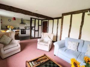 A seating area at Raven cottage at Cwm Chwefru Cottages