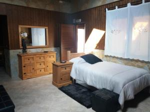 A bed or beds in a room at Casa Kely