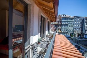 A balcony or terrace at LivingPorto Apartments by Porto City Hosts