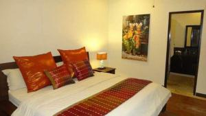 Un ou plusieurs lits dans un hébergement de l'établissement Villa Red Wood Forest