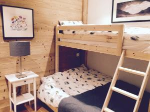 A bunk bed or bunk beds in a room at Grand Paradis