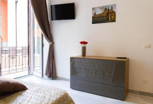A television and/or entertainment center at Palazzo Caltagirone Apartments
